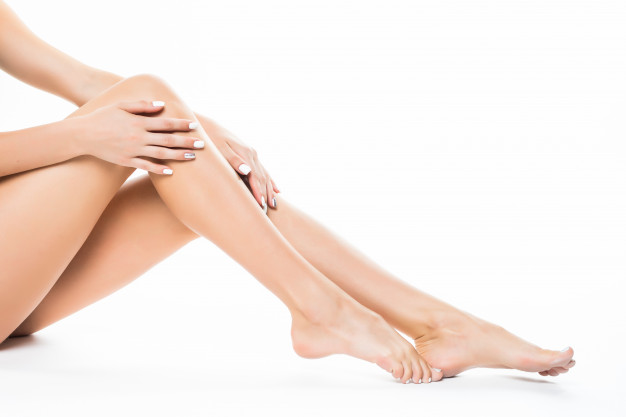 beautiful-female-legs-ass-back-body-isolated-white-wall-lying-floor-with-long-leg-beauty-spa-skin-care-concept_231208-3817