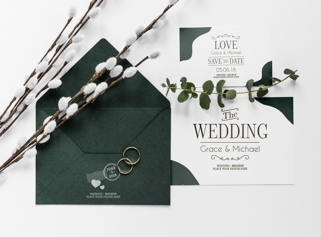 top-view-wedding-cards-with-envelope-rings_23-2148530359